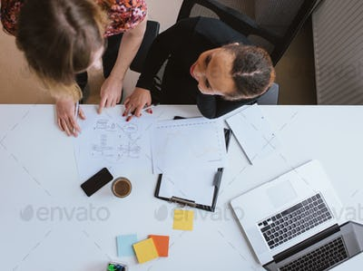 Two young woman working together on a new business project