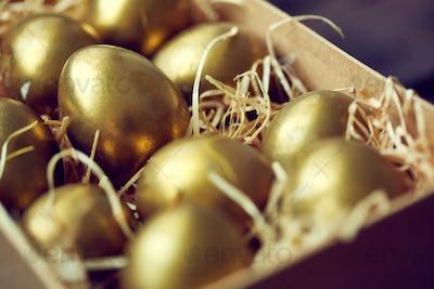 Golden eggs in container