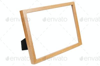 Wooden empty photo frame on white background