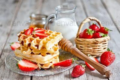 Waffles with strawberry abd honey