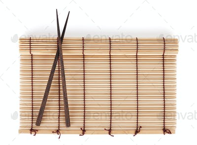 Chopsticks over bamboo mat
