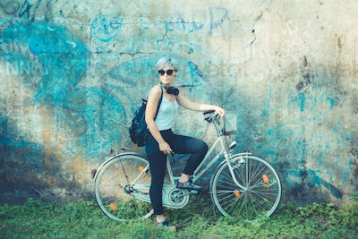 young beautiful short blue hair hipster woman with headphones an