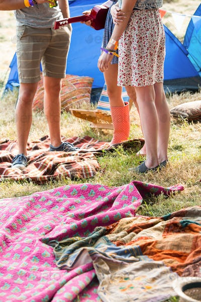 Hipsters having fun in their campsite on a sunny day