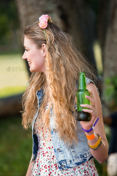 Blonde hipster having a beer on a sunny day