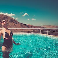 Pin up girl jumping in the swimming pool