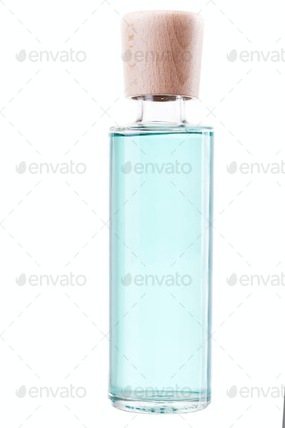 Glass with color perfume on white background