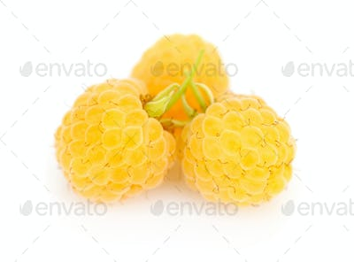 Fresh yellow raspberries on white background