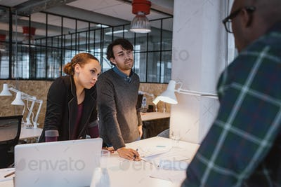 Diverse team of young professionals in a meeting