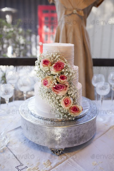 three tiered wedding cake with roses