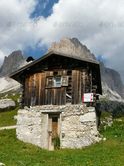 Wooden log cabin in the Dolomites