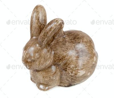 Rabbit shaped candle on white background