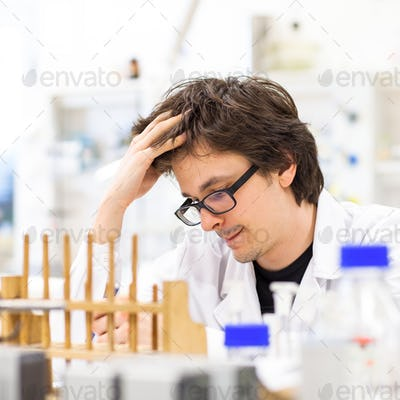 Male researcher carrying out scientific research in a lab (shall