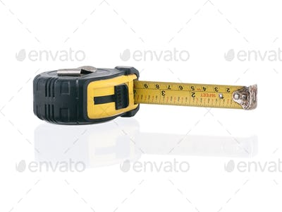Old dirty measuring tape laying on side isolated on white background