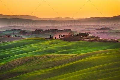 Crete senesi, rolling hills on sunset. Rural landscape near Sien