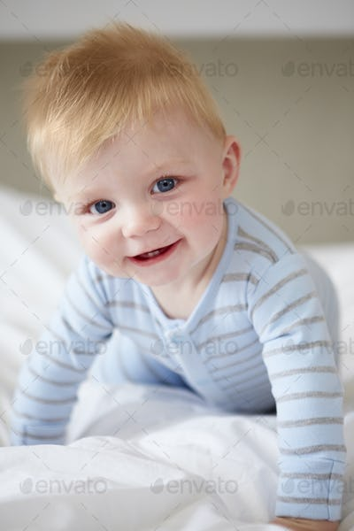 Young Baby Boy Playing In Bed