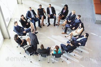 Businessman Addressing Multi-Cultural Office Staff Meeting