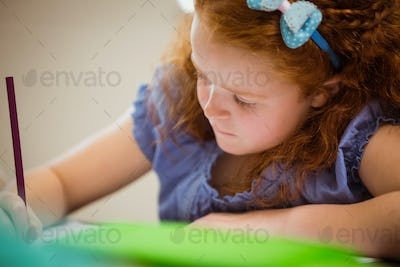 Pupil working hard at desk  at the elementary school