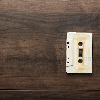 Retro Audio Cassette Over Wooden Background