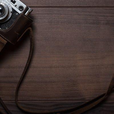 Wooden Background With Retro Still Camera