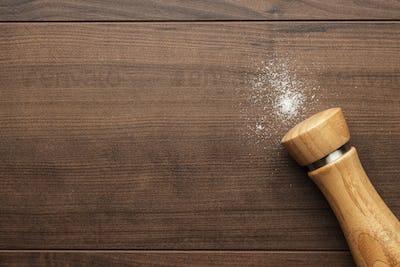 Wooden Salt Shaker On The Table