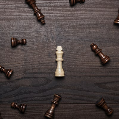 Chess Figures On The Brown Woden Table Concept