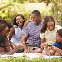 Group Of Young Friends Having Picnic Together