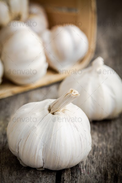organic garlic bulbs close up on a wooden background