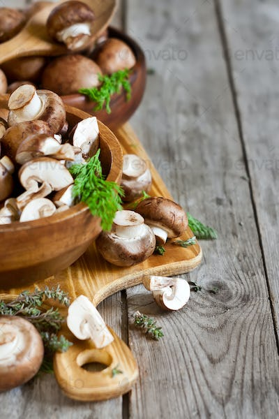 Mushrooms in bowls background