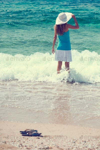 Woman enjoying sea waves