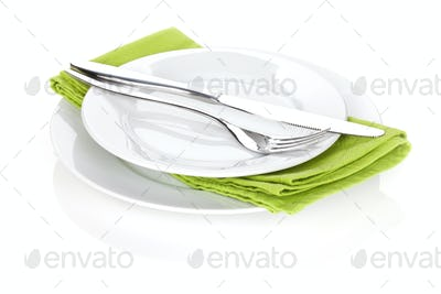 Silverware or flatware set of fork and knife over plates