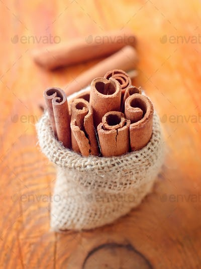 Aroma cinnamon sticks on the wooden board