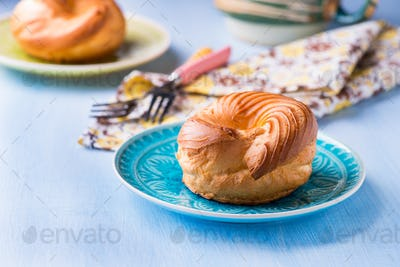 Choux pastry eclair ring with custard cream