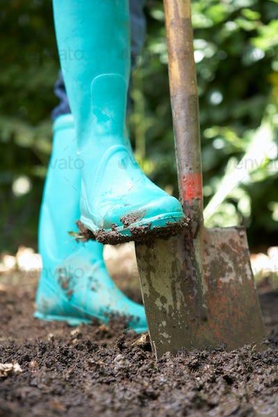 Person digging in garden