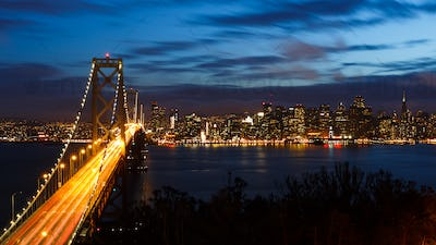 San Francisco Bay Bridge and skyline at night