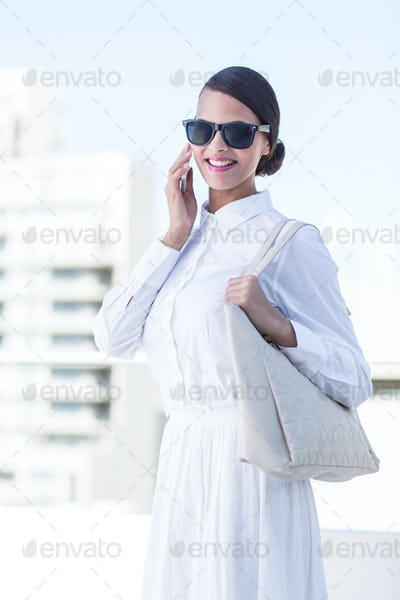 Beautiful woman oh the phone outside