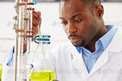 Scientist Studying Liquid In Flask
