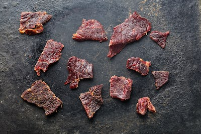 beef jerky on old black table