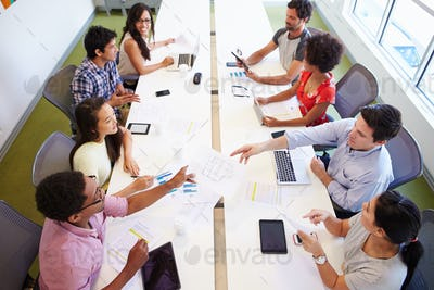 Overhead View Of Designers Meeting To Discuss New Ideas