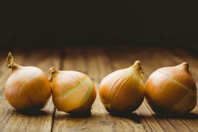 Fresh onions on wooden background