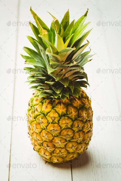 Fresh pineapple on wooden background