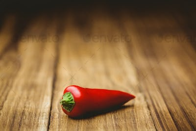 Red chili on wooden background