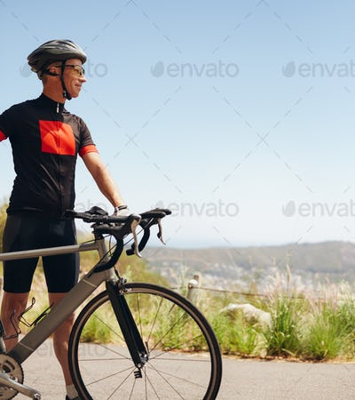 Happy male cyclist on the country side
