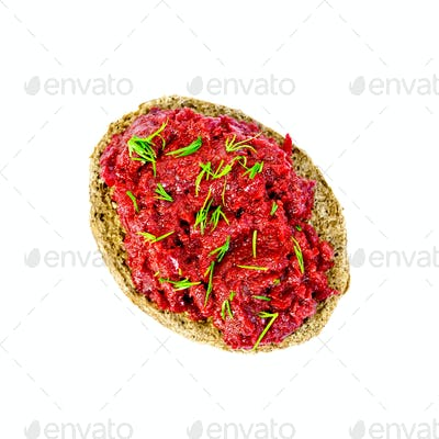 Sandwich with beet caviar and dill on top