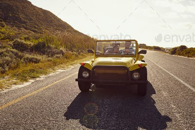Young couple on a road trip in beach buggy