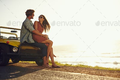 Young couple in love on a road trip
