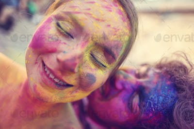 Bride and groom in the city with holi powder