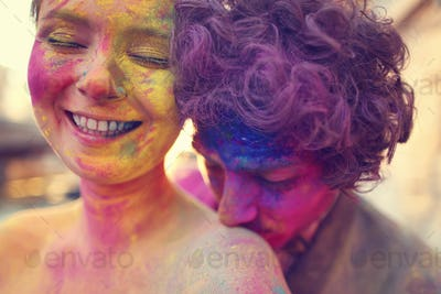 Lovers in Paris with holi powder
