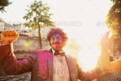 Groom having fun with holi powder
