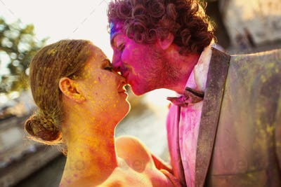 Portrait of a bride and groom having fun with holi powder