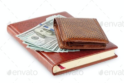 Diary and brown leather wallet with a wad of hundred dollar bill